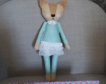 handsewn felt little doll with lace skirt