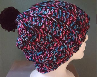 black pink teal crocheted hat