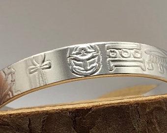 Hieroglyphics Pattern Embossed Cuff Bracelet