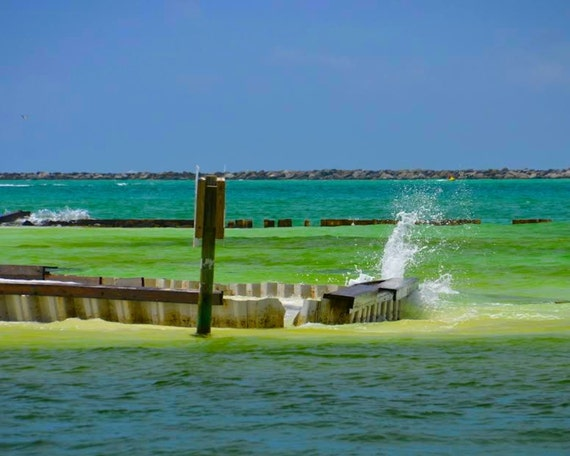 Waves breaking over the jetty in Destin, Florida (canvas)