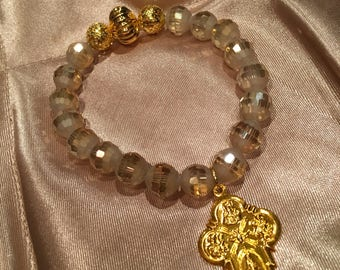Handmade Faceted Golden Crystal Stretch Bead Bracelet with 4 way Cross Charm