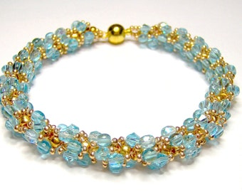 Turquoise spiral bracelet, blue and gold bracelet, turquoise bracelet, twist bracelet, beadwoven bracelet, aqua bracelet, beadwork bracelet,