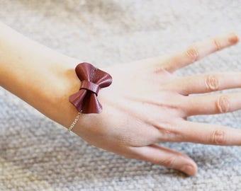 garnet colored leather bow bracelet