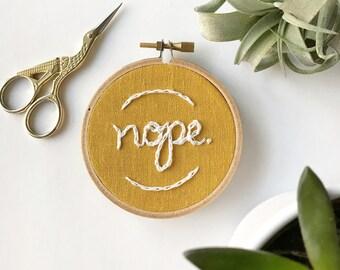 nope embroidery hoop art