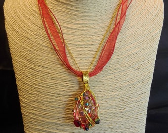 Red shadow crystal wire wrapped with gold wire and rainbow colored glass beads pendant necklace