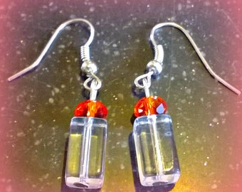 Handmade Unusual earrings . Acrylic cubes topped with a red crystal bead