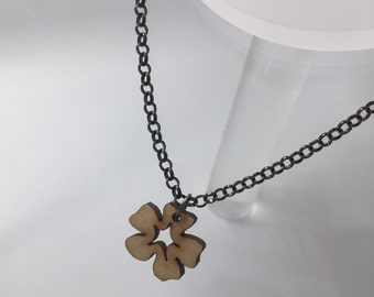 Small Flower wood Necklace. Laser cut from birch laser ply. by Emily M A Parkin