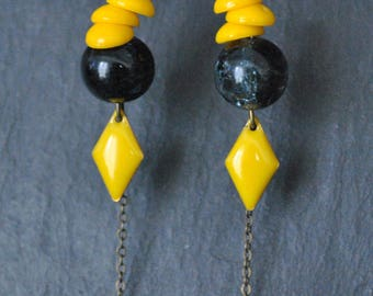 Yellow and black dangling earrings