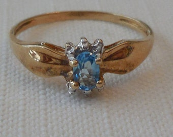 Blue Topaz ring with possible diamonds - Size 6 3/4