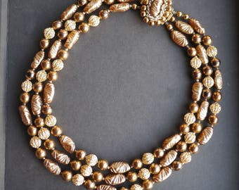 Gorgeous golden brown triple stranded beaded necklace 1950s