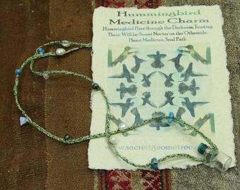 Humming bird feather medicine necklace
