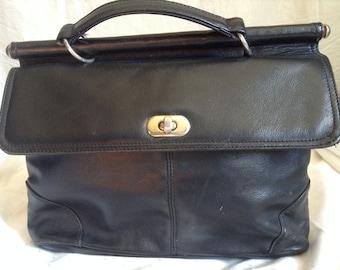 Vintage black leather, hand carry bag.