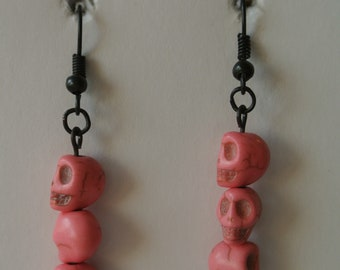 Three Small Pink Skulls with Black Fishhook