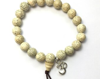 Beautiful White Lotus Seed Bracelet with Silver-Tone Om Charm - other options