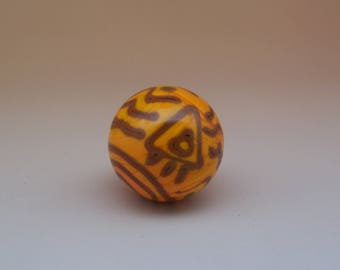 Fascinating lampwork glass marble in dark yellow with petroglyph-styled lines in brown, flamework glass art marble