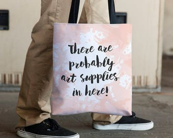 Gift for artists: There are probably art supplies in here tote. Gifts under 25. Gift ideas for an artist. Artsy gifts. Pink and gray tote.