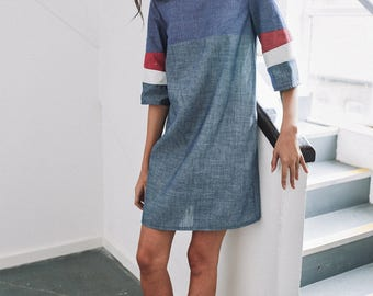 organic chambray shirt dress with red and white geometric panels on sleeve