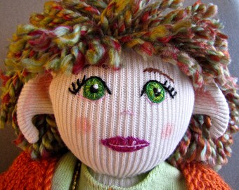 Handmade Cloth Doll 'Poppy', a faerie doll crafted from recycled clothing & thrift shop trims