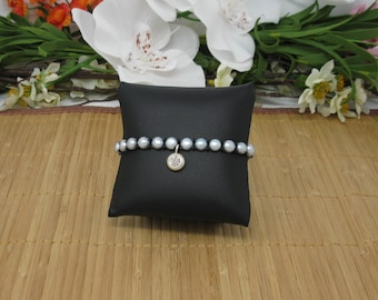 Om Sterling Silver Charm on Freshwater Pearl Bracelet with Seed Beads