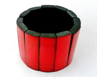 Vintage early plastic or bakelite  stretch bangle, red and black