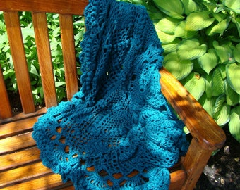 Crocheted circular teal doily afghan with hearts and lovely puffed pineapple stitching