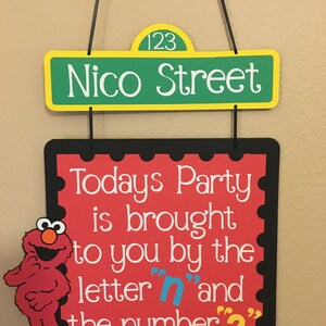 "Elmo Birthday party door sign, Today's Party is brought to you by the letter ""N"" and the number ""3"""