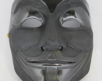 Polished black clay Guy Fawkes mask