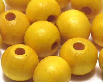 Set of 40 round beads 10mm yellow wood