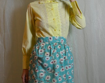 60s blue cooking apron with floral pattern