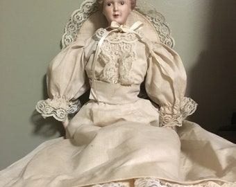 Porcelain Doll with Off White Dress
