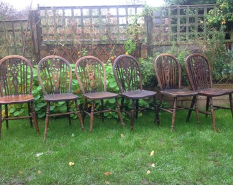 Sold Six wheel back kitchen dining chairs
