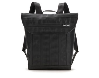 Black urban backpack. Weatherproof and recycled. Handmade in Italy from inner bike tubes