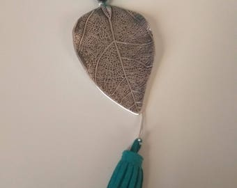 Necklace made by artificial suede cord, ceramic bead, silver antique tone Leaf pendant and suede tassel