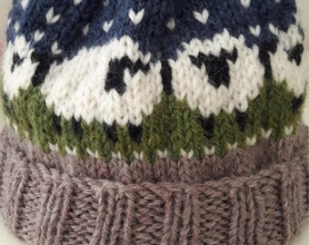 Child's Beanie. Hand Knit . Pure Wool . Aran Weight. Sheep Pattern. Winter Scene. Fold up Brim. Age 2 to 6. Warm