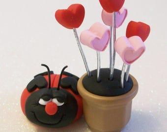 Love bug with heart flowers, Miniature Ladybug and heart plants, fairy garden, terrariums