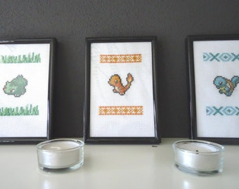 Framed cross stitched Bulbasaur, Charmander and Squirtle