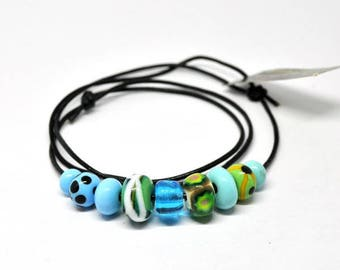 Handmade beads. A light turqoise/blue and green set /necklace/bracelet for vikings