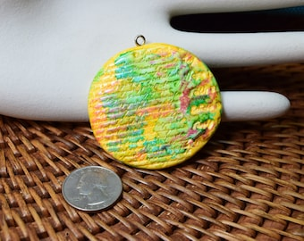 Yellow stamped polymer clay pendant