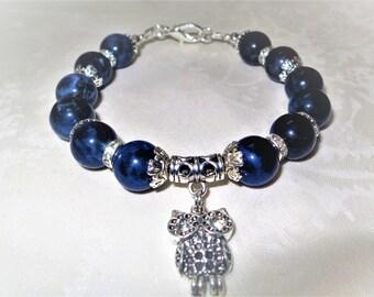 Bracelet from sodalite. Bracelet made of natural stones. Bracelet with owl.
