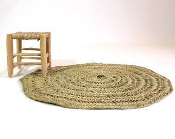 Round handmade woven rug.