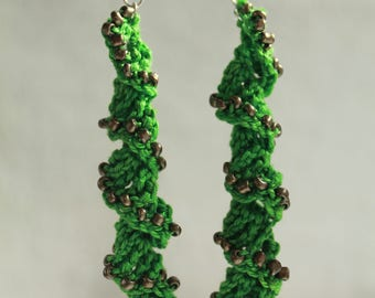 Green spiral dangle earrings with brushed brass beads