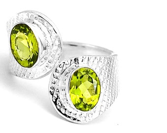 Silver ring 925 and natural peridots 55 adjustable size. Adjustable peridot and 925 sterling silver ring size 7