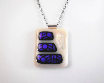 Pendant Necklace in beige fused glass and Dichroic blue, black and glass clear Dichroic, 18 inch stainless steel chain.