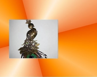 Large Peacock pendant in bronze and its real feather
