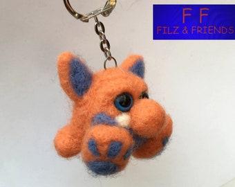 Monster key fob, sitting orange