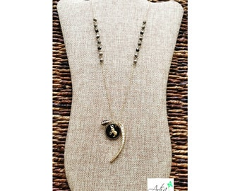 Hematite beaded necklace with rhinestones horn and enameled elephant charm.