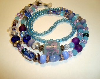 Blue Eyeglass Lanyard with :ampwork Glass Bead with Purple Accents, Czech and other Beads in Shades of Blue, with Rubber eyeglass holders