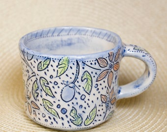 Pottery Cup with Flower and Fruit Inlay