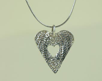 Fine Silver Handcrafted Echinoid Heart Pendant