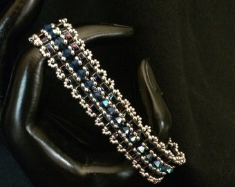NO 68 Hand woven crystal and glass bracelet